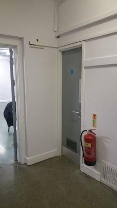 Door to room behind bakery, off hallway Site Visit, Bakery, Home Appliances, Doors, House Appliances, Appliances, Bakery Business, Bakeries, Gate