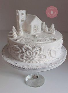 A traditional rich fruit cake, decorated white on white to give the feel of purity and serenity. Decorated with a royal icing church and a piped pattern around the sides of the cake, the wording is 'Silent Night, Holy Night. X