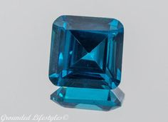 Beautiful 7.15 Carat Faceted Square Cut Blue Zircon from Brazil.  Price includes shipping and insurance.    The measurements of the gem are 9.92mm x 9.92mm x 5.95mm.    Zircon is undoubtedly the most brilliant blue gemstone, which has a higher refractive index than even sapphire, tanzanite and spinel. Although zircon is not well known by the general public, which are usually apt to confuse it with cubic zirconia (CZ), a synthetic diamond simulant. Zircon is a natural mineral called zirconium…