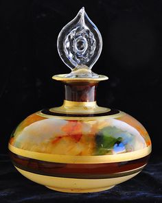 Gorgeous hand blown autumn colored perfume bottle with crystal gold trim stopper!