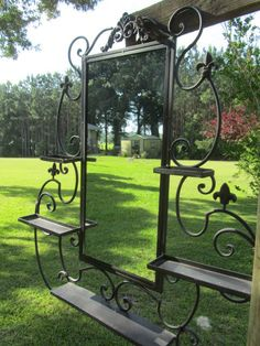 Large Ornate wrought iron mirror with shelves. This will be awesome in a salon. Size : 31 X mirror is 12 X shelves are deep, top shelves 5 wide, middle shelves 9 wide, bottom shelf 16 wide. Shabby Chic Spiegel, Shabby Chic Mirror, Ornate Mirror, Metal Mirror, Wrought Iron Candle Holders, Wrought Iron Decor, Iron Furniture, Welded Furniture, Metal Art Projects