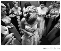 Prayer with the bridesmaids before the bride walks down the aisle.