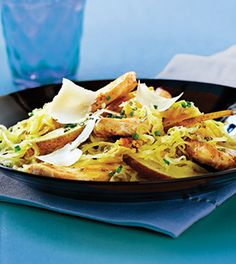 Delicate curls of spaghetti squash stand in for traditional pasta in this cheesy chicken dish. For extra bite, serve with a toasted whole-grain baguette.