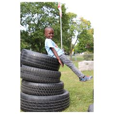 """Outdoor Provocation: A child began experimenting with balancing on tires. Rather then asking the children to take the tires down we provided them with a direct prompt """" How many ways can you make your body balance?"""" Risky play is important and with supervision/ guidance children can are given oppourtunites to learn how to evaluate safety and to coordinate their bodies."""