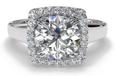 Cushion French-Set Halo Engagement Ring.  Cushion cuts are my fav...they are so sparkly!