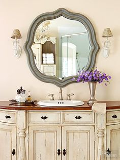 Wood countertops flawlessly finish vanities crafted from vintage furniture or antique cabinetry. This wood countertop makes a style statement (and withstands splashes) due to its medium-tone stain and multiple coats of high-gloss polyurethane./