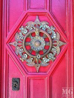 Metal design on hot pink door.