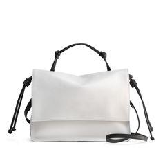 Leather bag, $550; vonholzhausen.com