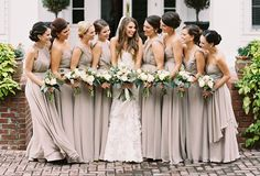 The bride wore an Allure Bridals gown, while bridesmaids wore Allure Bridesmaids in mocha