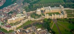 ENGLAND | Windsor Castle | An aerial view of the castle: (l to r) the Lower Ward, the Middle Ward and Round Tower, the Upper Ward, with the Long Walk in the lower right hand corner. The River Thames can be seen in the upper left of the picture.