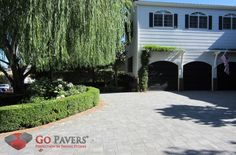 """This sweeping driveway in Encino utilizes Belgard's Catalina pavers in a traditional stone color, Rio. These pavers offer clean, sharp lines and a smooth, even surface that screams sophistication. Even better, when paired with a contrasting red (""""Valencia"""") Belgard Holland stone border as seen here, the entire enterprise gains a """"pop"""" that simply cannot be ignored."""