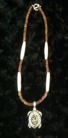 17 Wood Beaded Necklace w/Natural Bone spacers & a Tropical Pewter Sea Turtle Pendant.