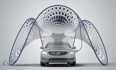 "Solar concept:  ""Created by L.A.-based firm Synthesis Design + Architecture, the ""Pure Tension"" concept is essentially a giant solar panel that can recharge the Volvo V60's batteries. What's so special about it? It folds up to fit in the car's trunk."""