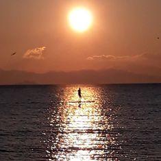 A MAN IN THE SUN  #maremma #toscana #italia #grosseto #follonica #tuscany #italy #mare #sea #spiaggia #beach #sunset #tramonto #island #bird  #people  #photooftheday #love #seaside #picoftheday #landscape #red #nature #nofilter  #elba #man #sun #sup #boat #waves