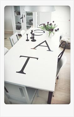 Love this!  You could stencil a white tablecloth instead of directly on the wood!