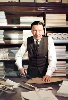 Robert Clark, head cutter at gentlemen's bespoke clothier Turnbull & Asser, est. London, Photo by Slim Aarons. Bespoke Shirts, Slim Aarons, Tailor Shop, Savile Row, Bespoke Tailoring, Tailored Suits, Costume, Well Dressed Men, Gentleman Style