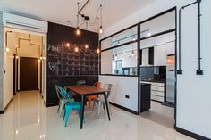 HDB 5-Room Premium Flat, 112sqm. Highlight of the house is the full length chalkboard at the dining area. Industrial theme design with brick wall tiles that bleed across the back wall in the living…