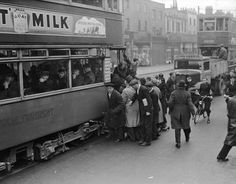 People boarding a tram in the Old Kent Road London, 1st May 1937.
