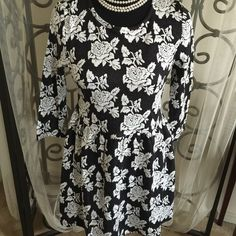 "NEW ... Super cute floral midi dress..size medium Super cute floral midi dress ...rear zipper ...size medium...35% cotton and 65% polyester...dress length is 30""...sleeve length is 15""...bust measurement laying flat is 15"" from armpit to armpit... Mebon Dresses Midi"