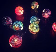 Galaxy Light Paper Lanterns. This string of lights consist of 10 three-inch round paper lanterns. Each lantern was handpainted with different colors to represent different nebula effects. The lanterns look great during the day, but can be lit up at night for a much more stellar appearance.