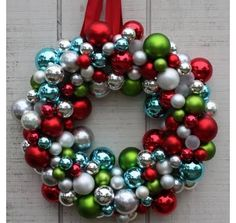 Bring a contemporary twist to your holiday wreath by using ornaments instead of greenery and winterberries. Becky from Matt & Becky used a Styrofoam wreath, red ribbon and a hot-glue gun to make this colorful, fun decoration.