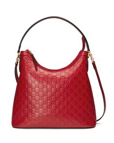 """Gucci Guccissima leather hobo bag with golden hardware. Flat top handle, 8"""" drop. Removable shoulder strap, 20"""" drop. Zip top closure. Back slip pocket. Interior, one zip and two slip pockets. Metal f"""