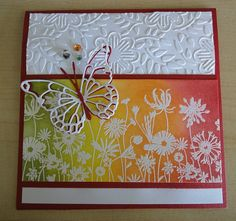 Colorful emboss resist. Love the layered butterfly for a pop of color.
