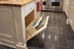 Here's another storage surprise in the island: a base cabinet tilt-out designed to hold cutting boards and cookie trays.