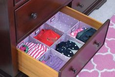 Organizing clothes in a dresser - use little bins that fit inside the drawers to create 'compartments'