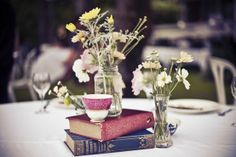 books: would be nice to use old pink/coral red/navy bound books as an accents for the cake/cheese table for table centres to raise the odd candle so everything's not the same height