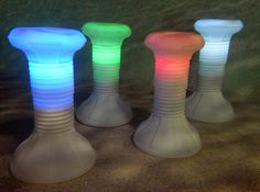 In-pool stools with built-in LED lighting