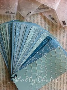 Embossing Folder Inventory. She uses Behr paint chips and lightly sands the pattern after embossing. Like her paint colors too.