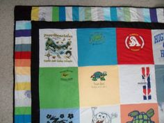 Old t-shirt quilt, the border is made from the sleeves & t-shirt scraps!