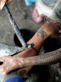 traditional Kalinga tattoo, by the mambabatok (tattoo artist) Whang Od, Philippines