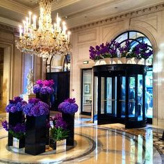Purple flower displays in the foyer of Four Seasons Hotel George V in Paris