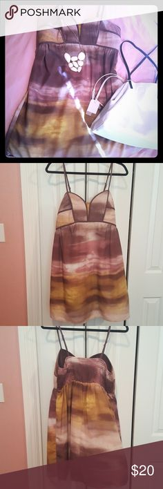 Beautiful Sunset Dress Beautiful dress with purples, pinks, and golds that mimic a california sunset. Structured bodice with flowy skirt. 100% polyester that feels like satin on. In excellent used condition. Xhilaration Dresses
