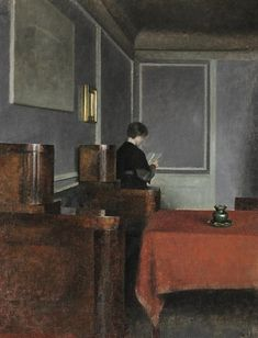 Interior with a woman seen from the back by Vilhelm Hammershøi