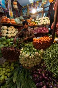 Vegetable vendors selling in India ~ photo by Suresh Menon