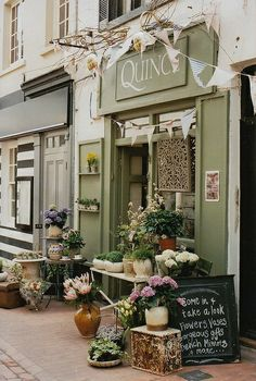 attractive storefront with florals and decor out front                                                                                                                                                      More
