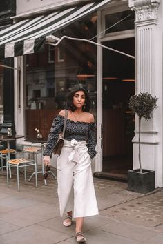 Fashion blogger Shloka Narang of The Silk Sneaker shares her tips on how to style a floral blouse for any spring or summer outfit featuring Topshop and Gucci