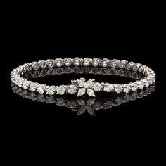 Tiffany & Co. Diamond Victoria Line Bracelet | From a unique collection of vintage tennis bracelets at http://www.1stdibs.com/jewelry/bracelets/tennis-bracelets/