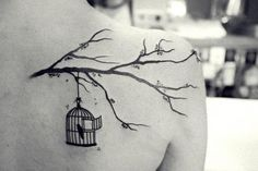 See more Bird in cage tattoos on back