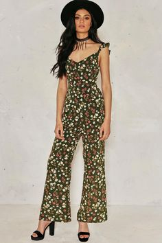 Floral tribute. Unveil your inner hippie chick in the Millie Floral Tie Back Jumpsuit, featuring a sleeveless design, fitted waist and floral print, perfect with boho headwear and a pair of killer heels.