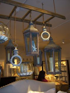 Pottery Barn lanterns.  Perfect for hanging off  tree branches.  Can use rope from the hardware store.