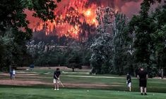 The Eagle Creek wildfire burns as golfers play at the Beacon Rock golf course in Washington state on 4 September. #golfcoursephotography
