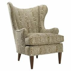 """Woodland whimsy defines this stylish wingback chair. Wrapped in faux bois upholstery and highlighted with nailhead trim, this captivating seat adds organic inspiration to your decor. Made in the USA.  Product: ChairConstruction Material: Wood and fabricColor: CamelFeatures:  Made in the USANailhead trim Dimensions: 43.5"""" H x 37.5"""" W x 34"""" D"""