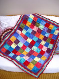 Granny square blanket - I love the blocky and colorful look of this.  I need to relearn how to make granny squares, apparently.