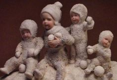 Did you ever have a snow ball fight?  With snow babies? four of them?   n decamp, three years ago.