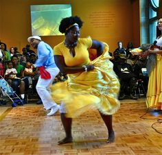 A dancer from the Afro-Cuban dance and drum group Alafia swirls her skirt in a dance inspired by the busy marketplaces in Cuba.