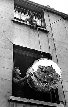 time for holiday parties | glitter | mirror ball | disco | lift | apartment | ball | party